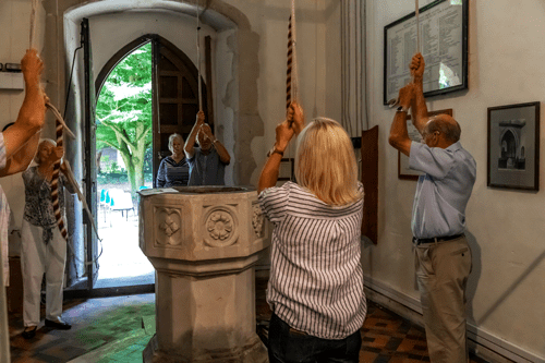 An image of bell ringers ringing church bells.